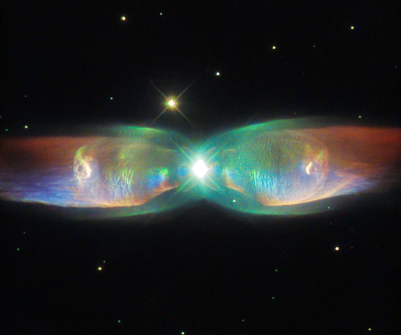 The Butterfly Nebula, also known as the Twin Jet Nebula, is an example of a so-called bipolar planetary nebula. The object of this study, K4-47, is much less known, but may be similar in appearance. Having nothing to do with planets, a planetary nebula is
