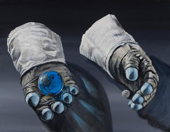 A pair of Lunar gloves cradle the Earth and Moon