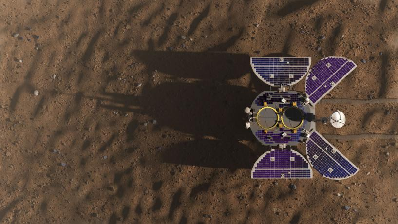 Looking down on the surface of Mars as the Chinese Zhurong Mars rover rolls into view.