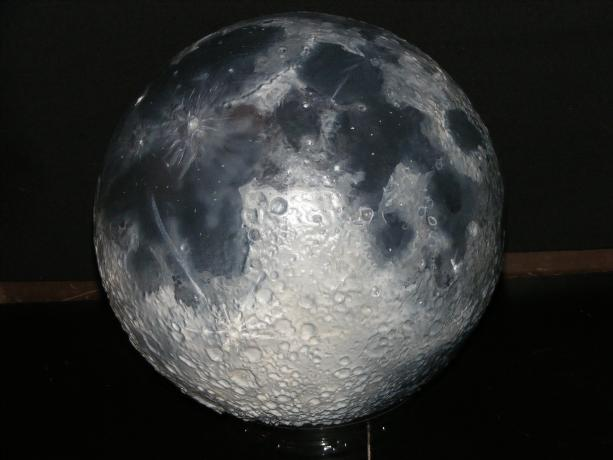 A raised relief globe of Earth's Moon.
