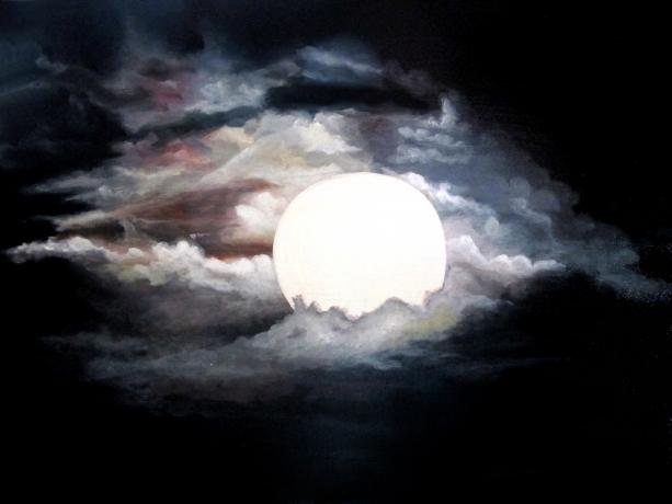 Full Moon brilliantly glowing, illuminates surrounding clouds against the black night sky.