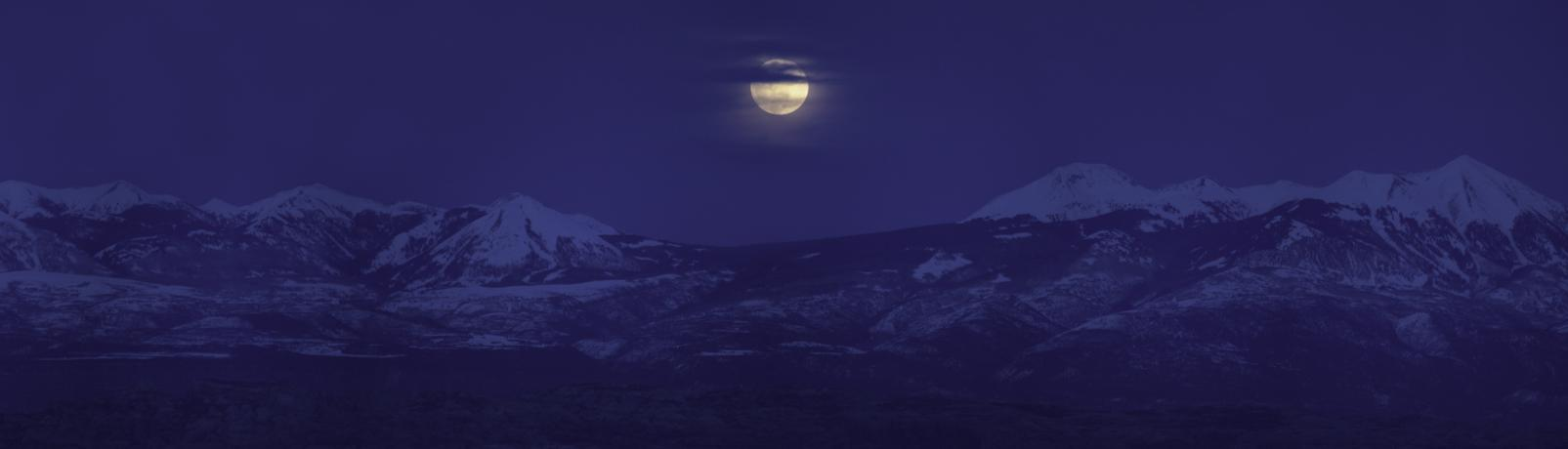 Supermoon rising over snow-capped Utah mountains