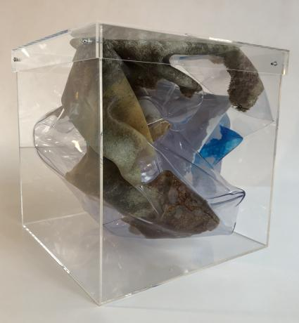 A map of an imaginary world painted on a large sheet of crumpled PVC and enclosed inside a 12 inch clear plexiglass cube.