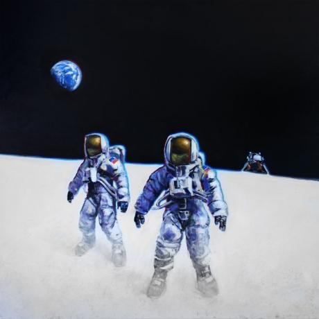 Two lunar explorers floating in a field of white on the moon.