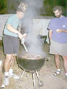 Cooking up 150 pounds of bratwurst makes even the serious eaters happy.