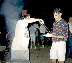 Mike Nolan serves up Greg Hoppa's very first Bratfest brat.