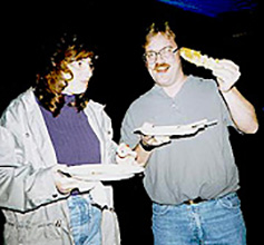 "Ron Fevig and his wife demonstrate ""all-you-can-eat."""
