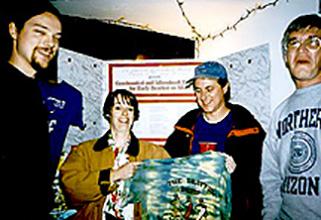 Joe Harrington, Linda Rowan, Bryan Butler, and Bobby Bus dig through T-Shirts of yesterbrats.