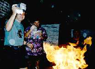 Bill does a little nuclear experimentation with lighter fluid and the brat barbecue.