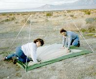 Betty and Jim set up their tent, NOT straddling the fault zone.