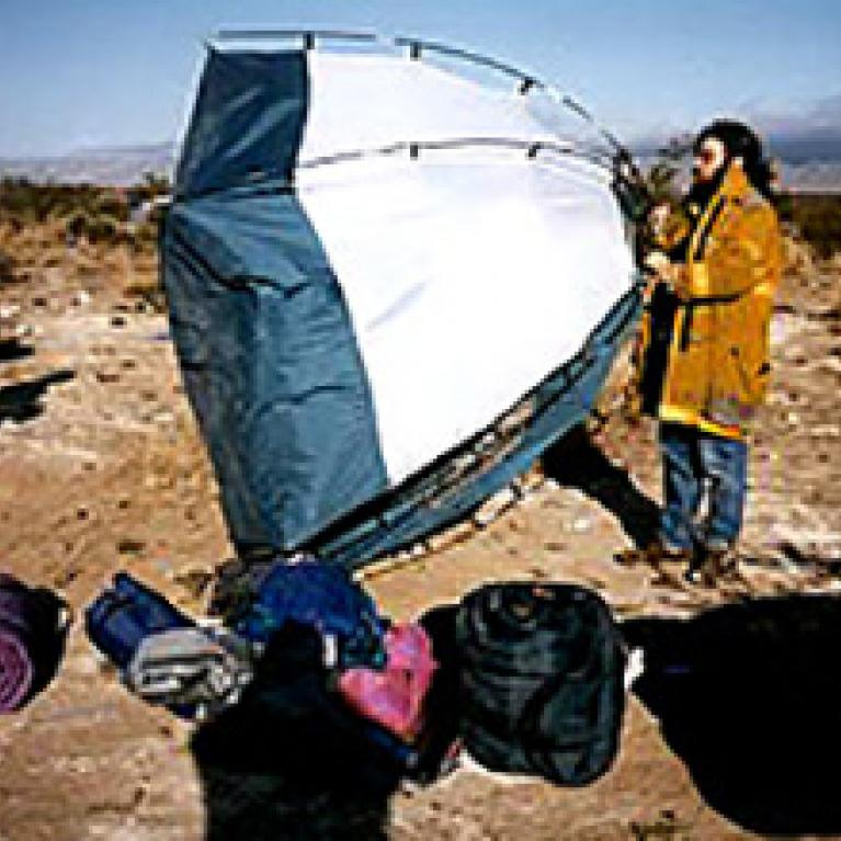 Andy flies his tent in winds that knocked down the wall of a mall in El Paso.
