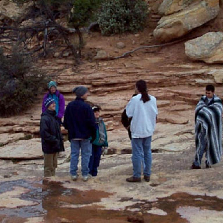 Big Chief Hurfordt and Company have hiked down to the base of one of the natural bridges.
