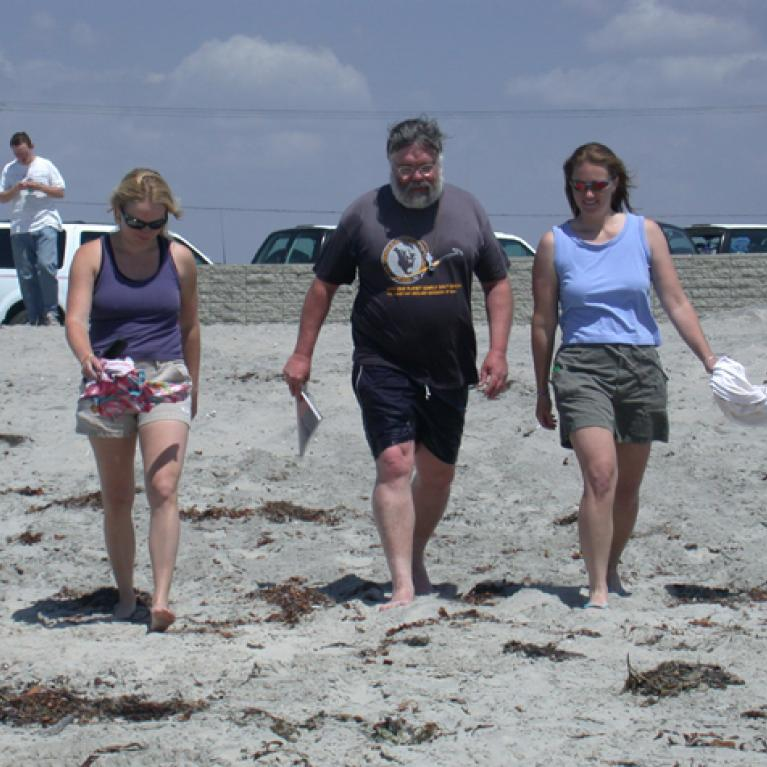 Ingrid and Jani channel Baywatch as they escort Jay onto the beach.
