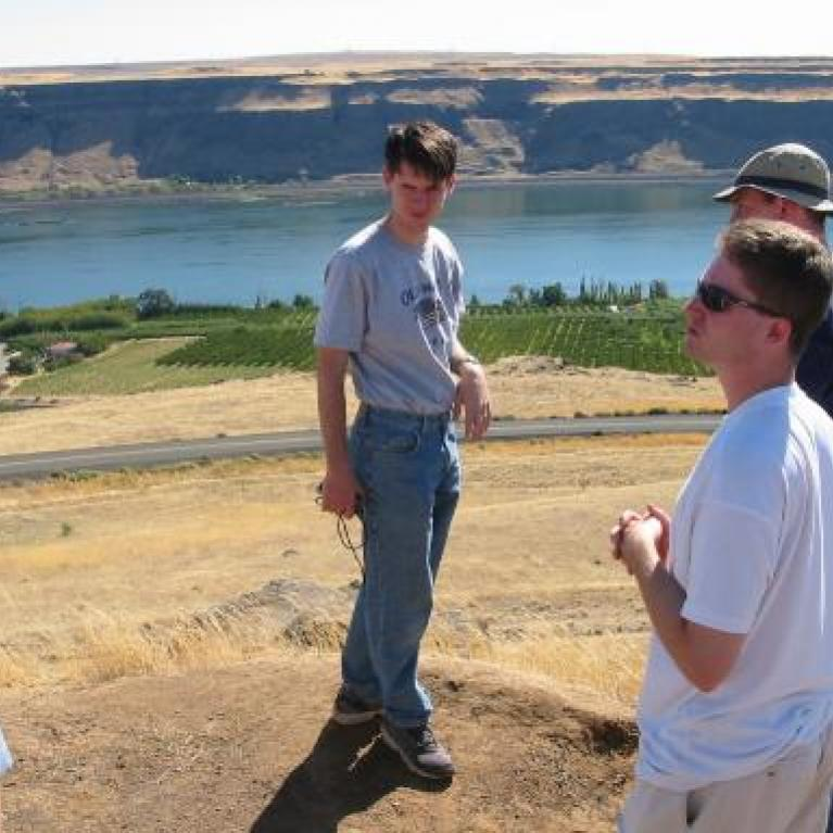 People overlooking the Columbia river.