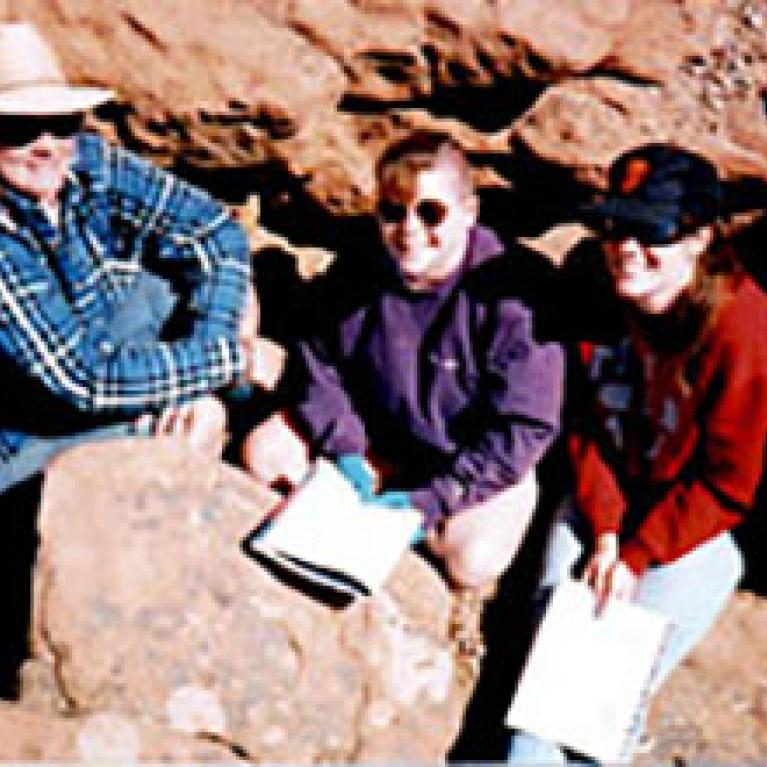 Cynthia, Barb, and Zibi try to keep warm in a rock crevice while learning about the mechanics of Plateau uplift.