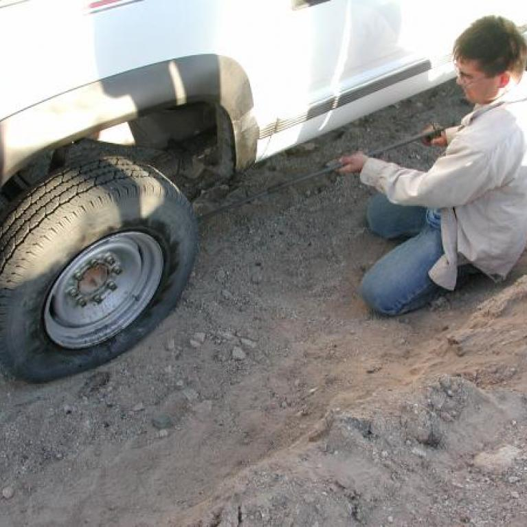 The monotony of the long journey home was interrupted by a flat tire.
