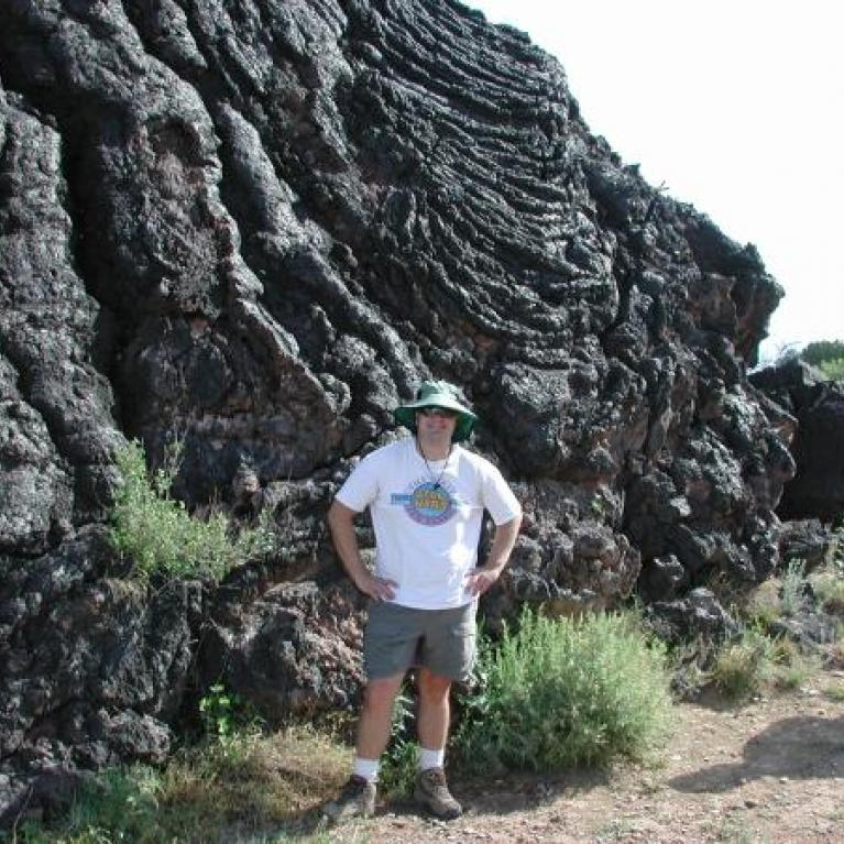 Laz in front of a lava flow.