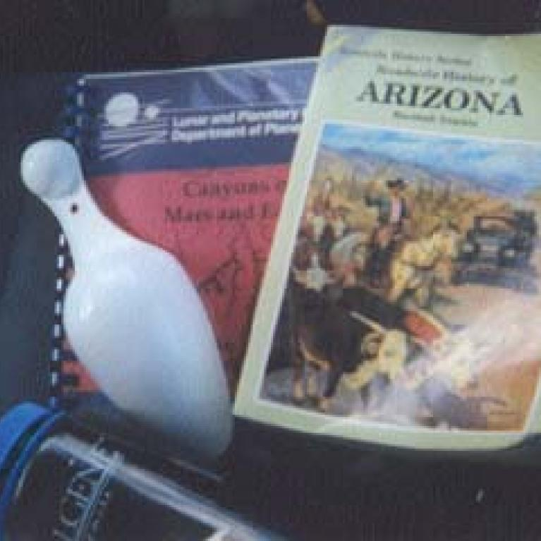When setting out on a Field Trip, it's important to have the right kind of supplies: water bottle, Roadside History of Arizona, Field Trip Guide, and the Ice Scoop.