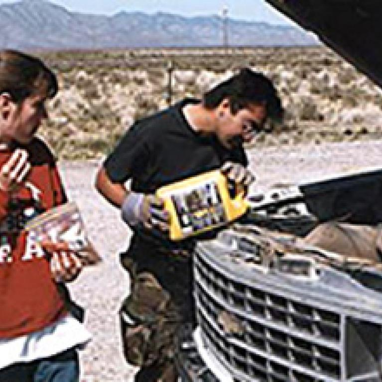 Laszlo tries all sorts of new coolants while the Zibi looks on and Will takes pictures of the ground. In the end, it was duct tape and twist-ties to the rescue--and the van was fine.