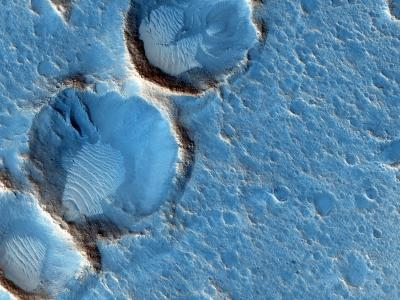 Martian wind-blown deposits inside eroded craters
