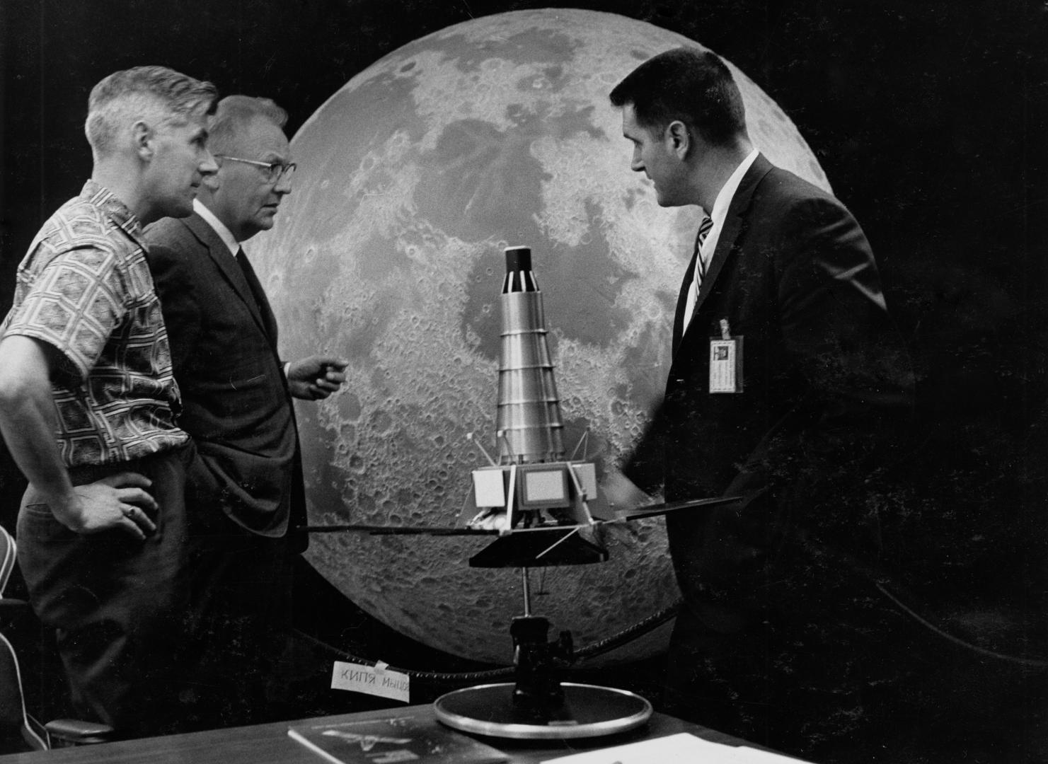Scientists Ewen Whitaker, Gerard Kuiper and Ray Heacock in front of a Ranger model and lunar hemisphere which is now located at Flandrau Science Center and Planetarium. / UArizona Lunar and Planetary Lab photo.