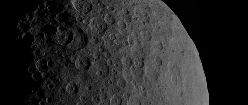 Ceres is a dwarf planet that orbits the sun between Mars and Jupiter. In this image, Ahuna Mons can be seen in the bottom right of Ceres's profile.