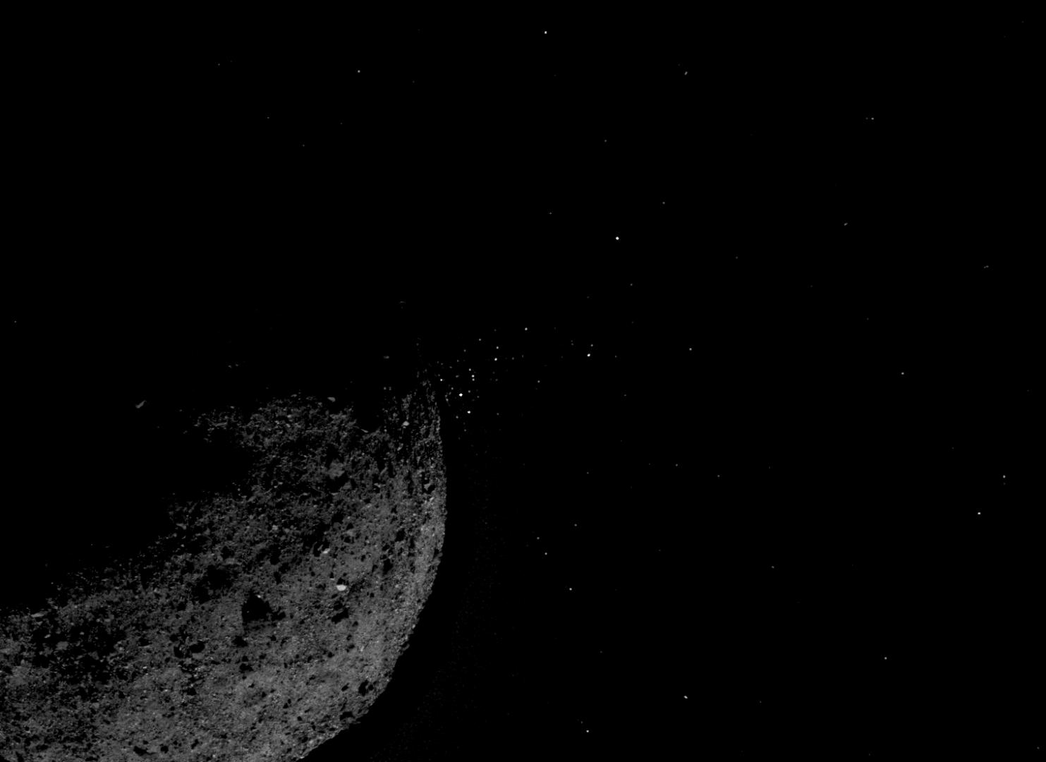 This view of asteroid Bennu ejecting particles from its surface on January 19, 2019, was created by combining two images taken by the NavCam 1 imager onboard NASA's OSIRIS-REx spacecraft: a short exposure image that shows the asteroid clearly and a long exposure image that shows the particles clearly. Other image processing techniques were also applied, such as cropping and adjusting the brightness and contrast of each layer.NASA/Goddard/University of Arizona/Lockheed Martin