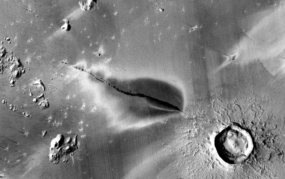 Recent explosive volcanic deposit around a fissure of the Cerberus Fossae system. NASA/JPL/MSSS/The Murray Lab