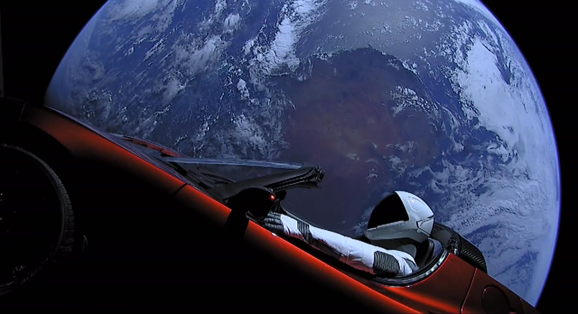 The Tesla Roadster and its mannequin passenger, Starman. This image was captured by cameras onboard the vehicle. (Image: SpaceX)