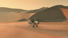 This illustration shows NASA's Dragonfly rotorcraft-lander approaching a site on Saturn's exotic moo