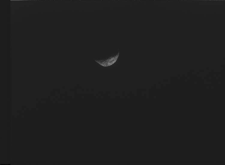 This image, the last one taken by the spacecraft, shows crescent Bennu with its night side melting with the complete black of space as the spacecraft pushed away from Bennu. The photo was taken with NavCam, one of three camera instruments designed and built by Malin Space Systems. NASA/Goddard/University of Arizona/Lockheed Martin
