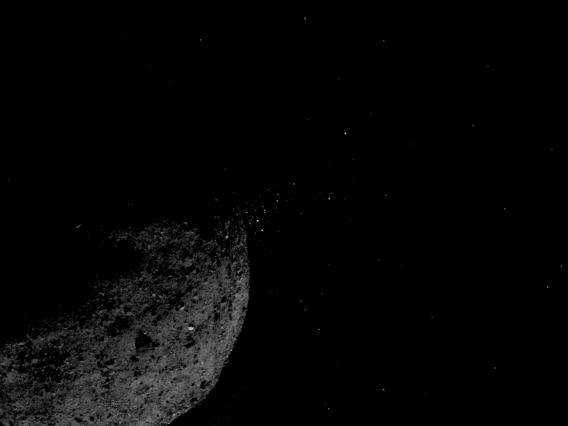 This view of asteroid Bennu ejecting particles from its surface on January 19, 2019, was created by combining two images taken by the NavCam 1 imager onboard NASA's OSIRIS-REx spacecraft. NASA/Goddard/University of Arizona/Lockheed Martin
