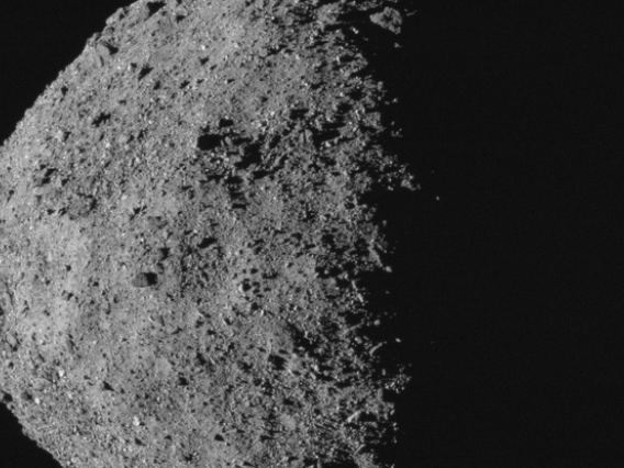 This image, showing asteroid Bennu's spinning-top shape, was taken by the MapCam camera on NASA's OSIRIS-REx spacecraft on April 29, from a distance of 5 miles. From the spacecraft's vantage point, half of Bennu is sunlit and half is in shadow. (Credit: N