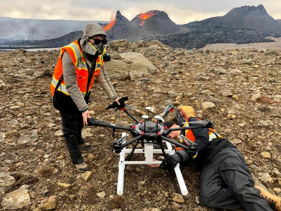 Two researchers attending to a drone.