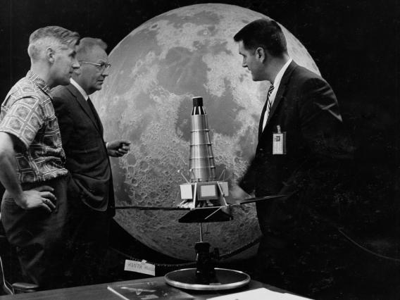 Scientists Ewen Whitaker, Gerard Kuiper and Ray Heacock in front of a Ranger model and lunar hemisphere which is now located at Flandrau Science Center and Planetarium. / UArizona Lunar and Planetary Lab photo