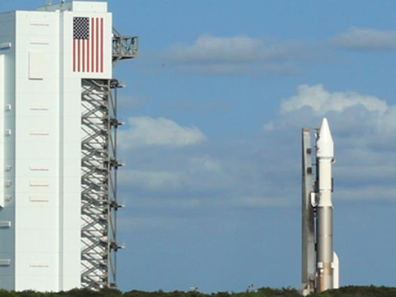 The Atlas V rocket carrying the OSIRIS-REx spacecraft was rolled out Wednesday morning from the Vertical Integration Facility (left) to Space Launch Complex 41 at Cape Canaveral, Florida. (Photo: Bob Demers/UANews)