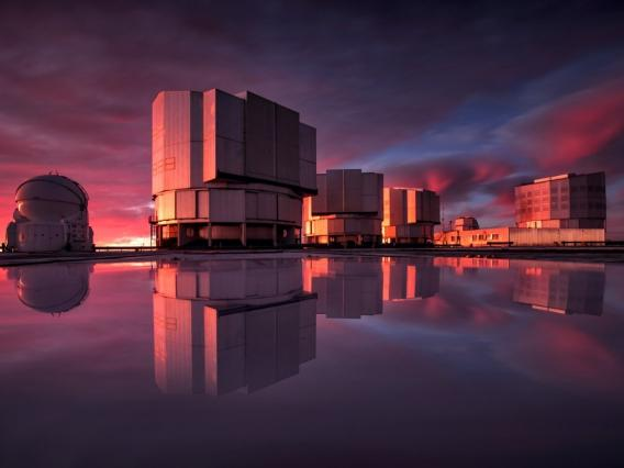 The Very Large Telescope, or VLT, at the Paranal Observatory in Chile's Atacama Desert. VLT's instrumentation was adapted to conduct a search for planets in the Alpha Centauri system as part of the Breakthrough initiatives. This image of the VLT is painted with the colors of the sunset reflected in water on the platform. A. Ghizzi Panizza/ESO