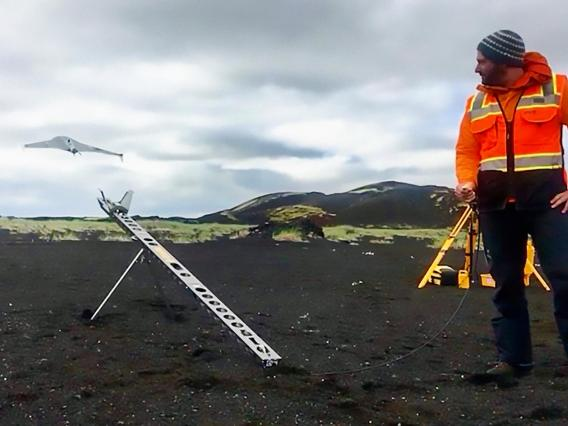 "Christopher Hamilton launches a drone during flight tests in the Holuhraun, Iceland lava flow field. RAVEN builds upon recent developments in drone technology – such as NASA's Ingenuity Mars Helicopter, accompanying the Mars 2020 rover ""Perseverance."""