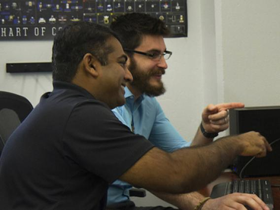 Reddy and Campbell examine their animation of a Chinese space station flyby. (Photo: Mari Cleven/Research, Discovery & Innovation)